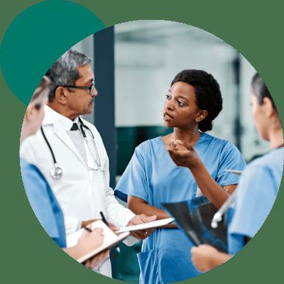 Clinicians discussing a handoff